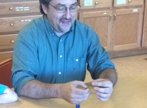 Brian demonstrates the batteries and diodes.
